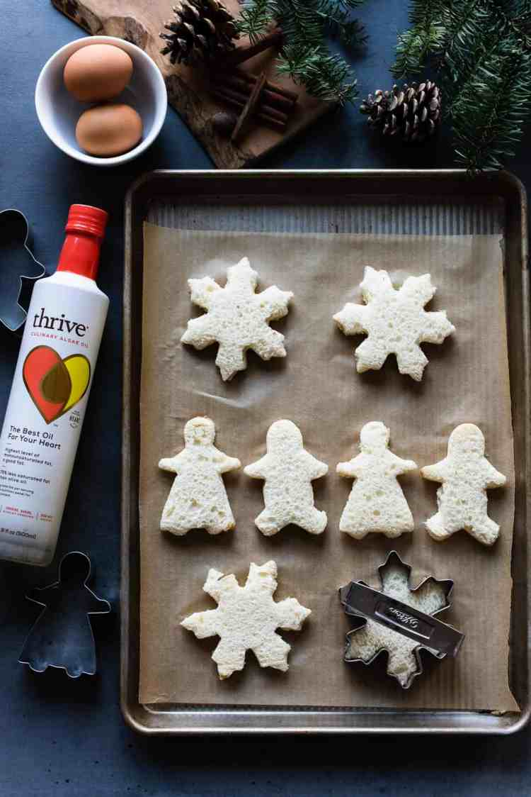 White bread gingerbread men and snowflake cut outs for Gingerbread French Toast.