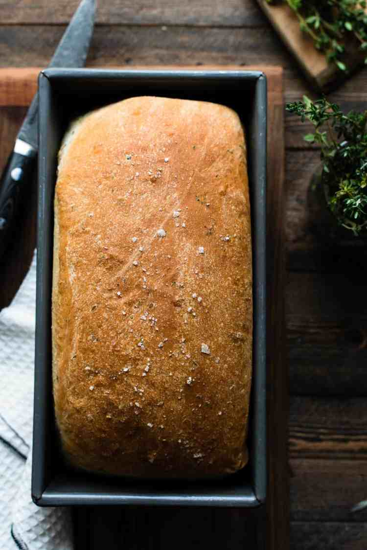 Savory Herb Stuffing Bread freshly baked in a loaf pan.