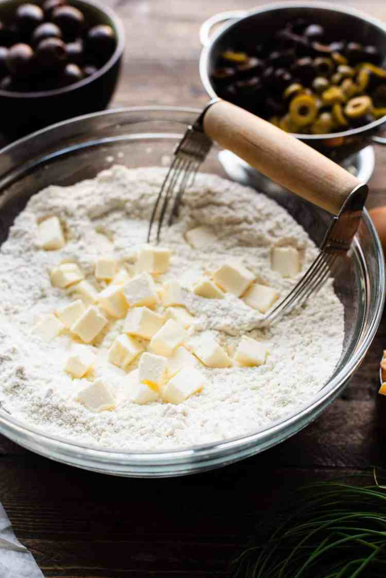 Cutting butter into flour for Olive Cheese Scones.