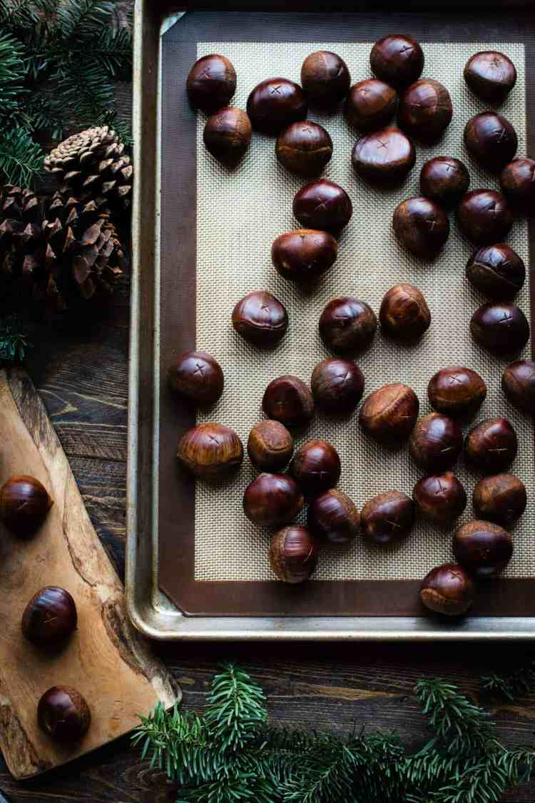 Oven Roasted Chestnuts on a baking sheet.