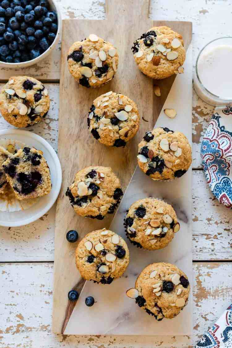 Blueberry Almond Muffins on a board.