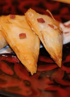Cardamom Goat Cheese Phyllo Triangles with Spiced Maple Yogurt Sauce