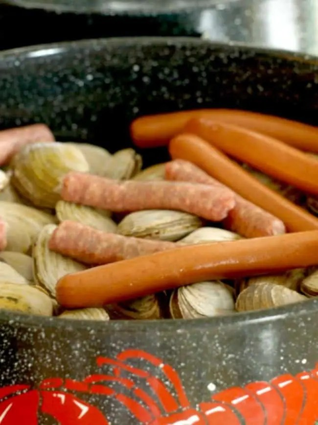 An image of a clam pot layered with ingredients and ready to be cooked over the fire or stove.