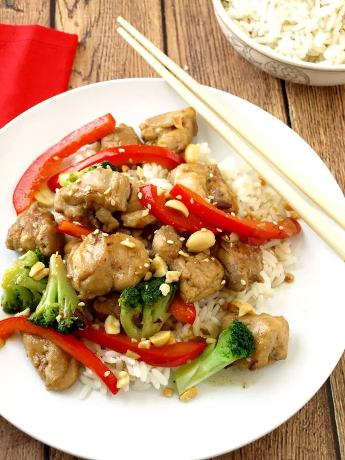 Lighter Kung Pao Chicken on a plate with chop sticks