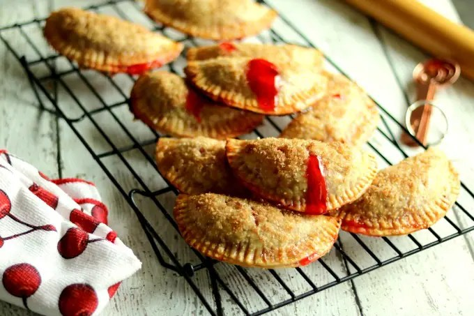These cherry hand pies are amazing. Frozen empanada pie dough rounds make these handheld Cherry hand pies quick and easy to prepare.