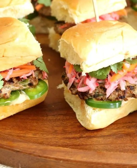 An image of banh mi sliders with pickled vegetables