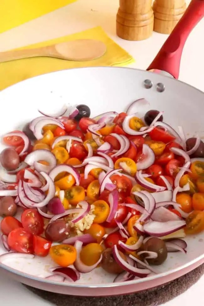 A pan of onions and tomatoes