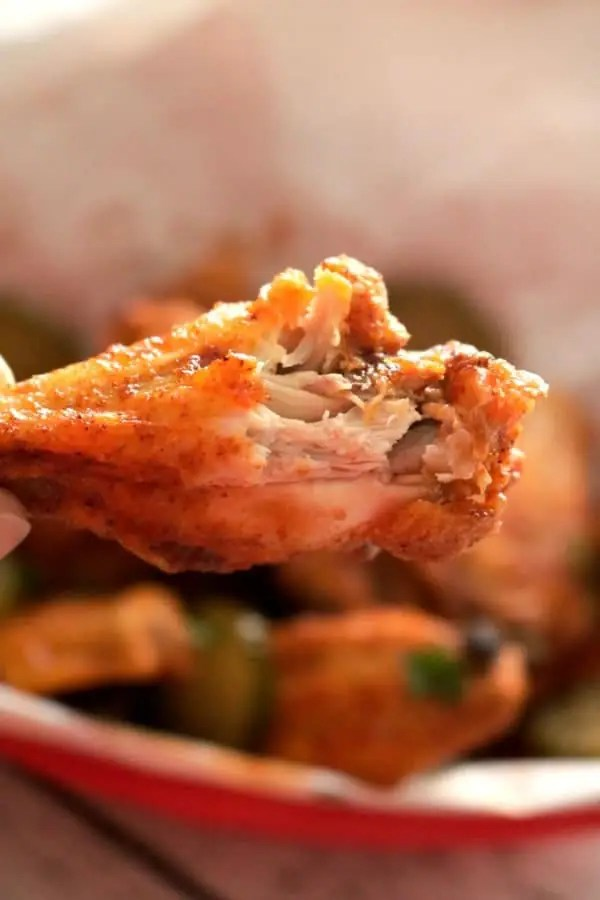A close up of a chicken wing