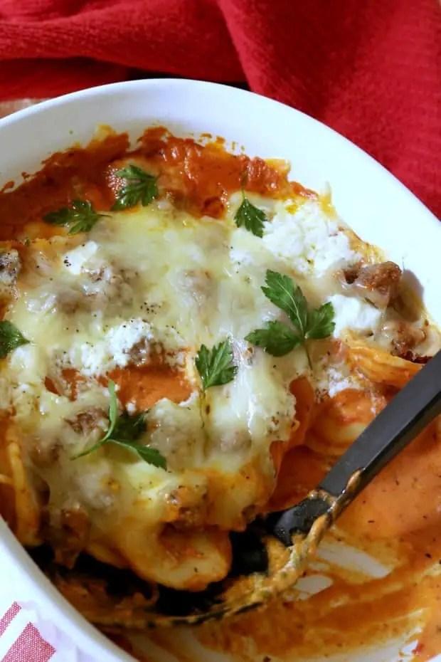 Half-eaten casserole of Baked Ravioli in Rosa Pasta Sauce.