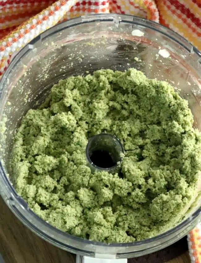 ground garbanzo beans with herbs and spiced blended in a food processor