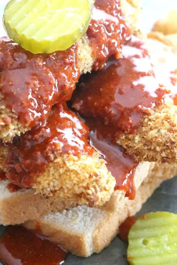 Close up of Air Fryer Nashville Hot CHicken Tenders piled high on white bread