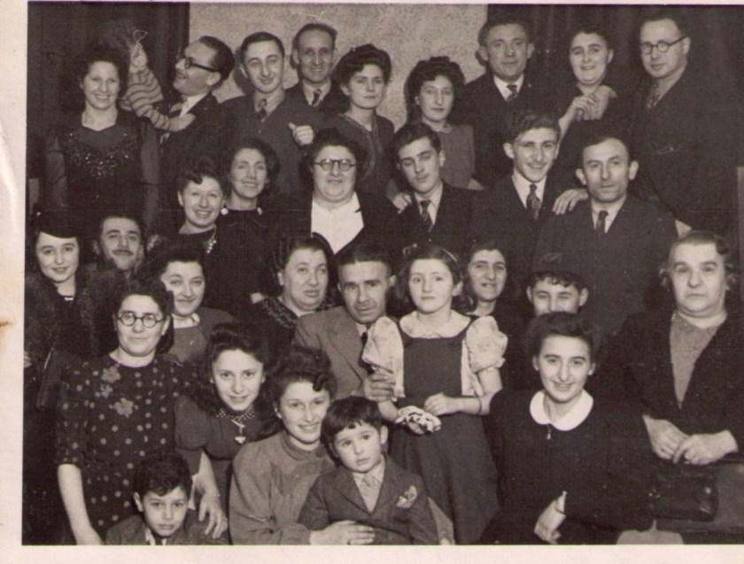 This photograph was taken in 1943 on the occasion of Trevor Glass's bar mitzvah. You can see several Bookbinders and Mendzigurskys. Peisech is on the right of the middle row, behind the lady with the handbag, who is Sarah Bookbinder Bowman.  Leiser Chil Mendizgurski is standing on the top row, third from the right