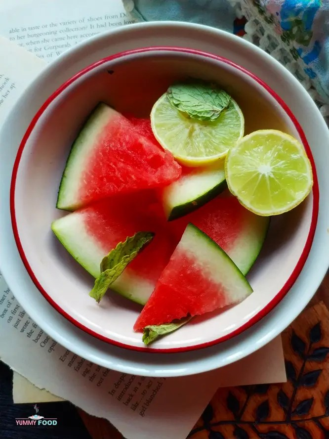 cut watermelon and lime slices in a plate for food photography