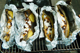 We made Banana Boats & stuffed them with marshmallows, chocolate chips, & graham cereal