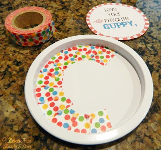 We started out snipping off pieces of the washi tape & lining it around the edges of the lid