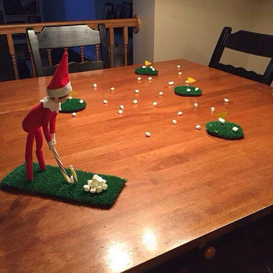 Elf playing golf