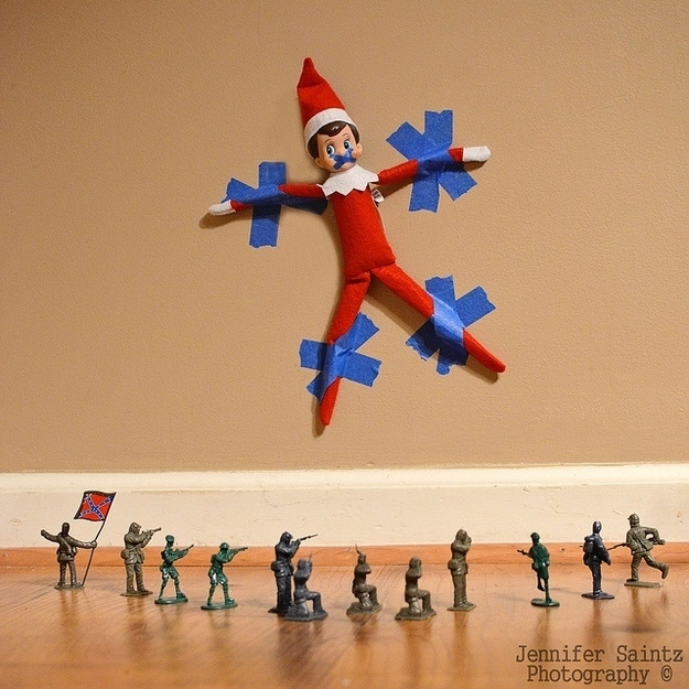 Elf Taped to a Wall with Soldiers