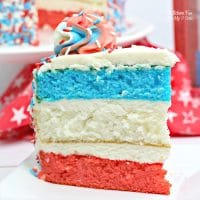 A Patriotic Layered Cake is a fun and festive dessert for the 4th of July! If you need a red, white and blue dessert to this Independence day, this is it.