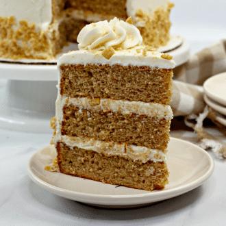A single slice of cinnamon toast crunch cake on a cream saucer