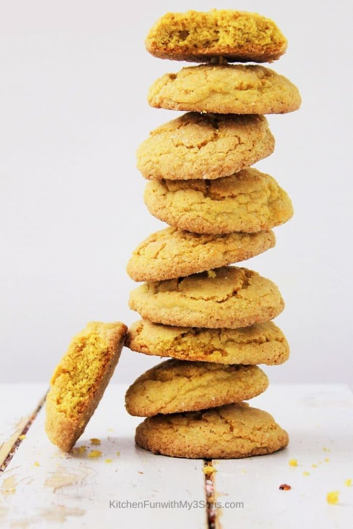 Stack of pumpkin spice sugar cookies on a white wooden surface