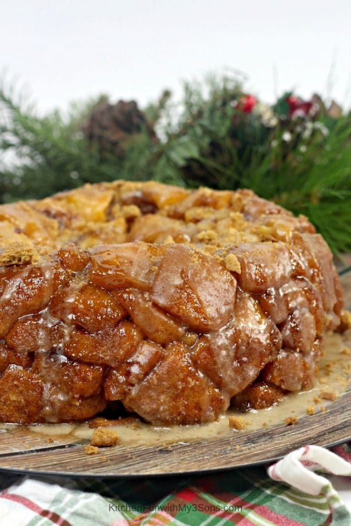 Gingerbread monkey bread on a wooden tray with greenery in the background