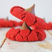 Red Velvet Peanut Butter Blossoms are the most delicious cookies! If you love red velvet cake and peanut butter, you will love this recipe.