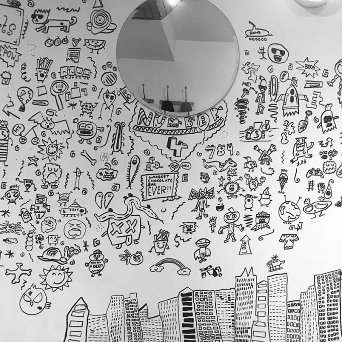 Kid Told Not to Doodle in Class Gets Hired by Local Restaurant to Decorate Their Walls