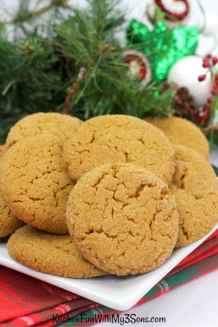 Ginger snap cookies on a white plate with holiday decorations