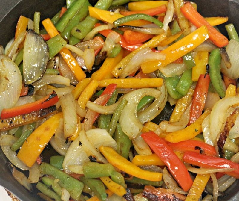 peppers and onions in a skillet