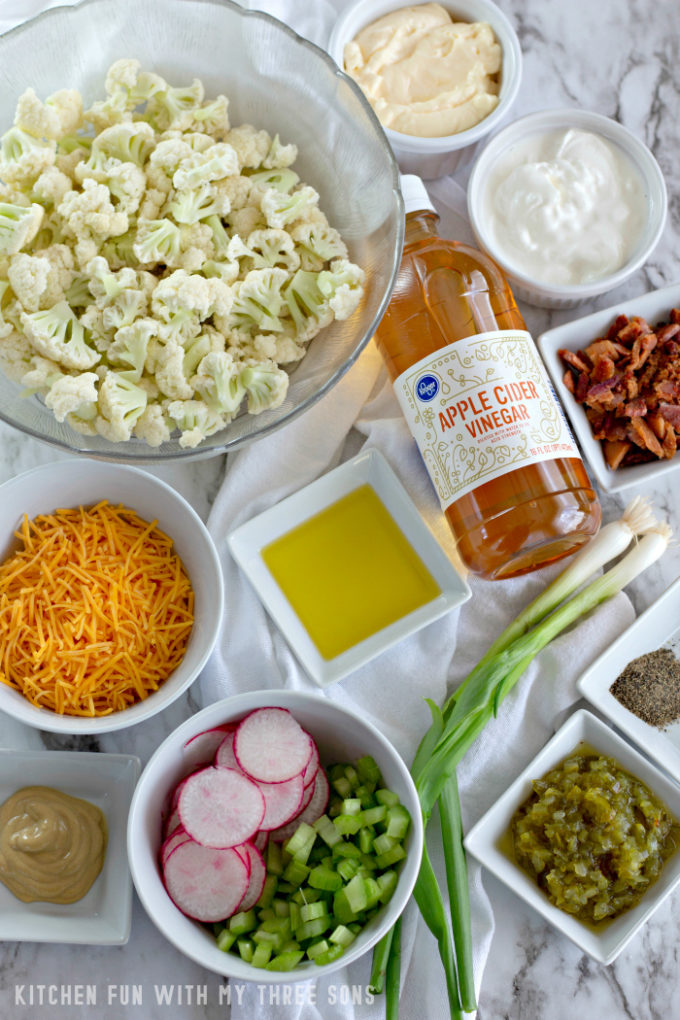 Ingredients to make Low Carb Cauliflower Salad on a marble counter