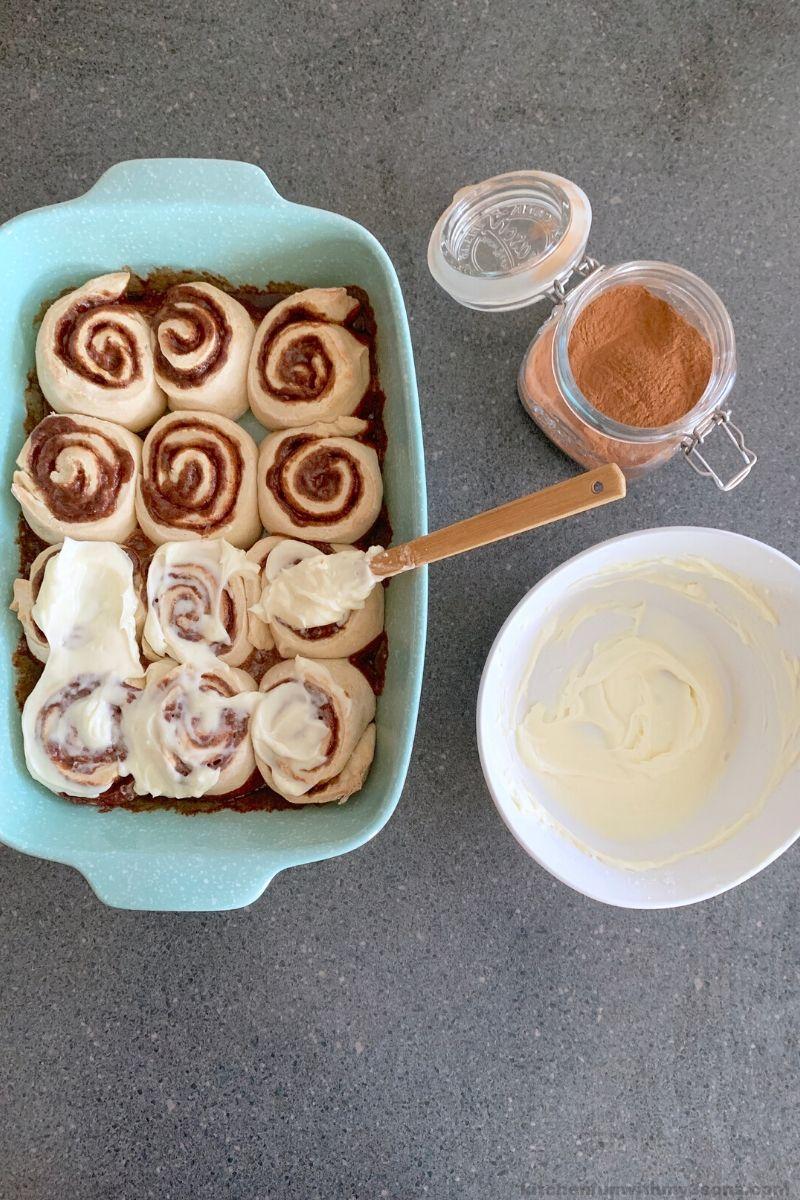frosting homemade cinnamon rolls