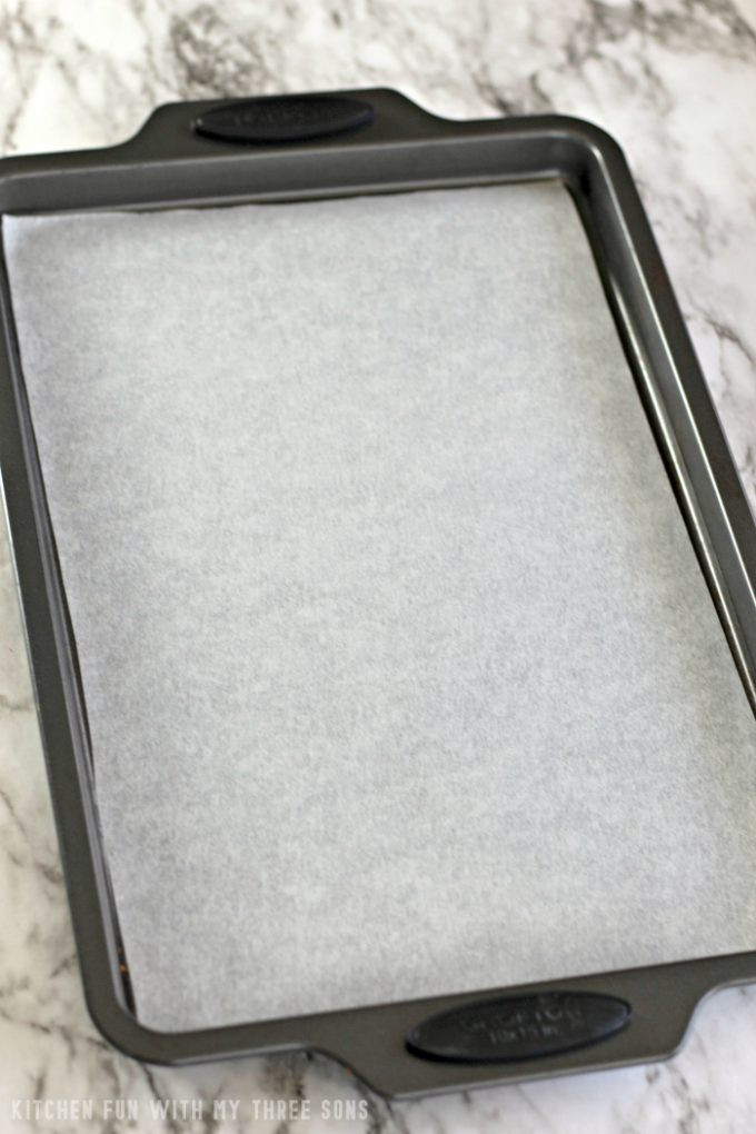 preparing a sheet pan with parchment paper