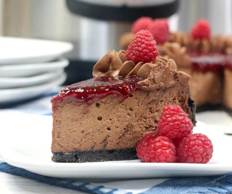 Copycat Chocolate Raspberry Cheesecake on a white plate