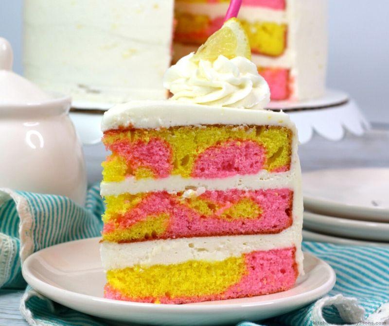homemade pink lemonade cake on a white plate