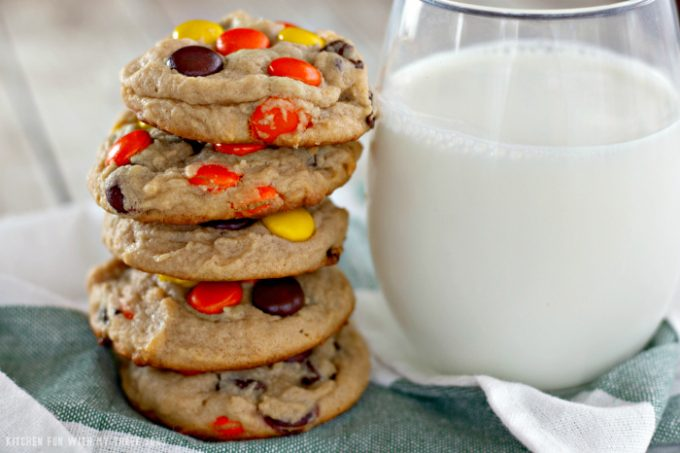 Reese's Pieces Peanut Butter Cookies with milk on a green and white towel