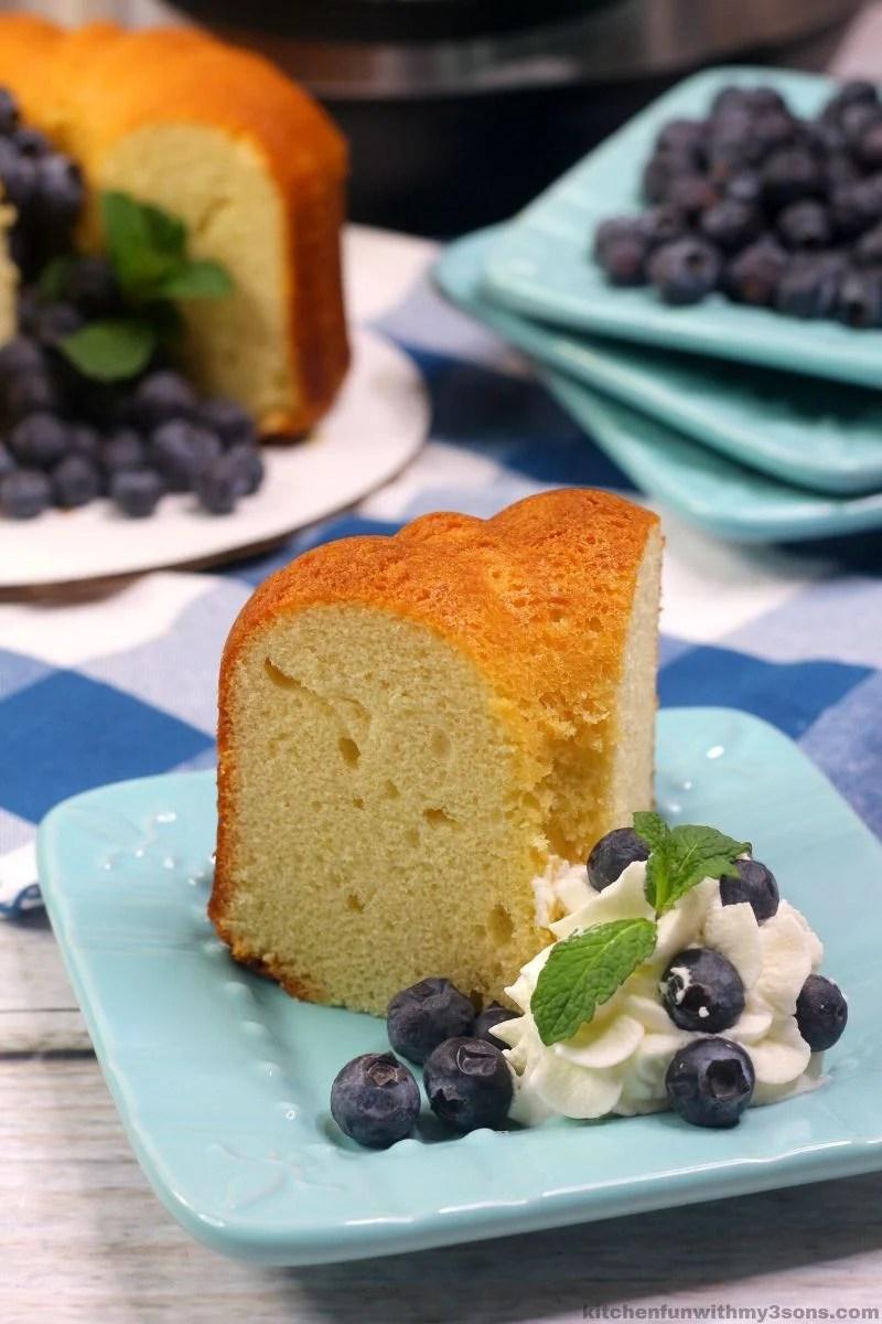 slice of instant pot pound cake on a blue plate