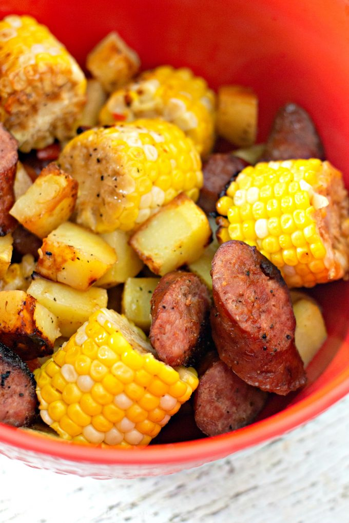 leftover Garlic Kielbasa Grilled Foil Packets in a red bowl