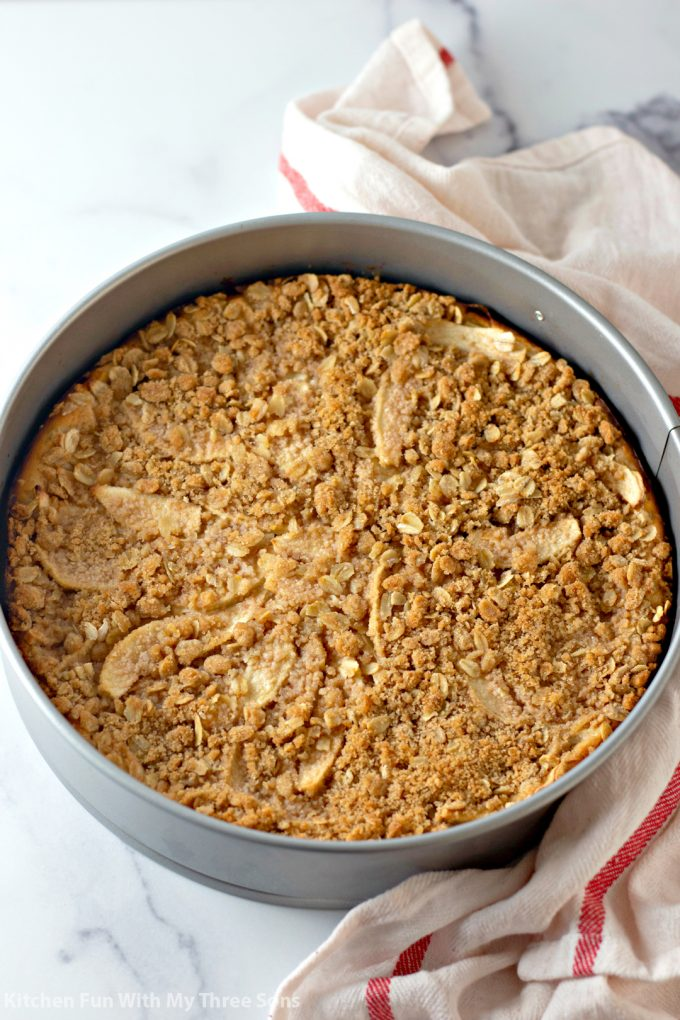 freshly baked cheesecake topped with crumb topping