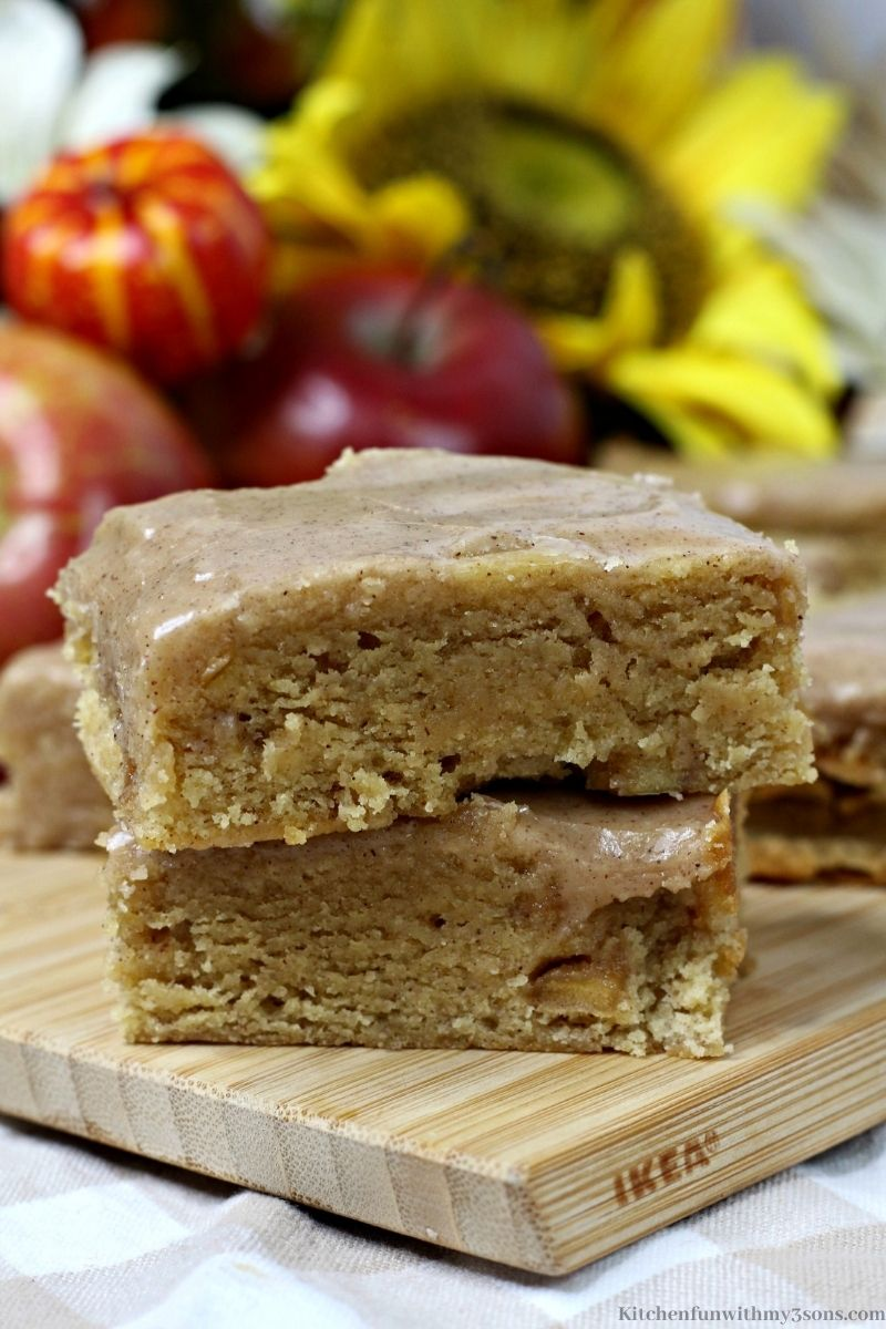 Close up of stacked Pumpkin Apple Blondies with Maple Glaze bars.