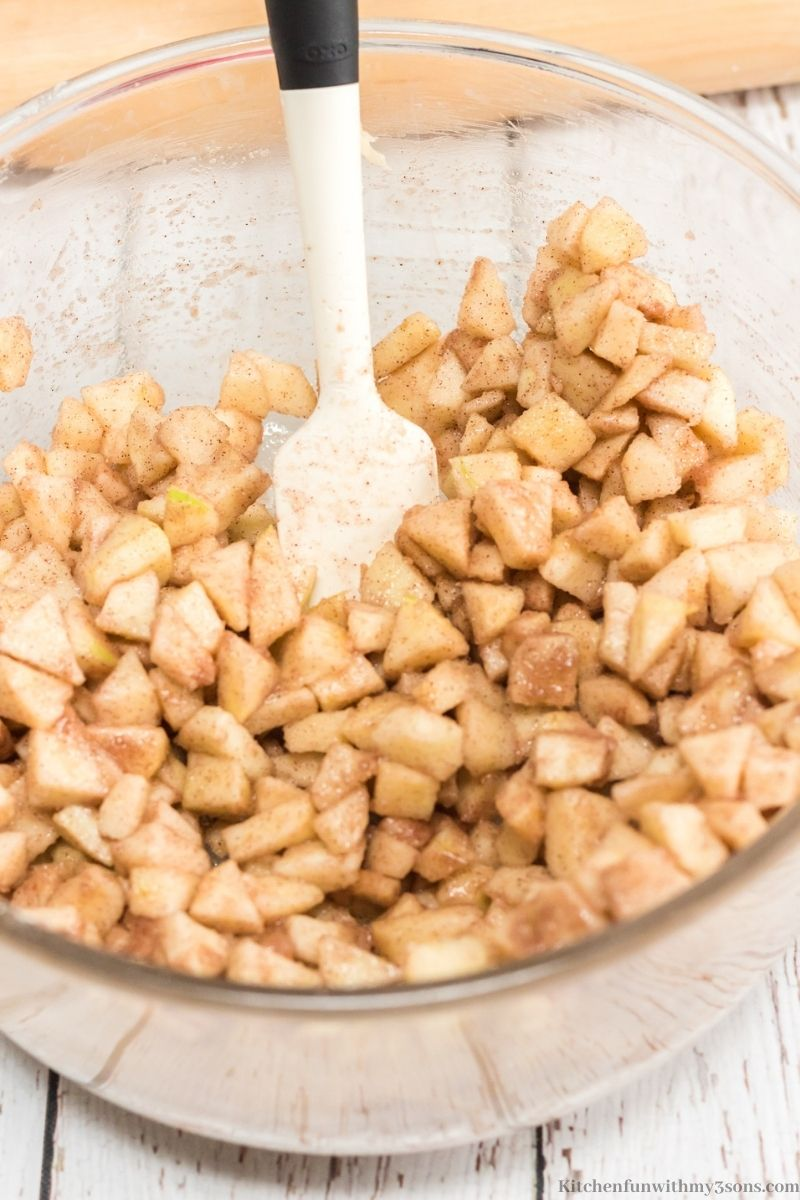 Your apples cut into cubes and mixed in with the cinnamon and sugar.