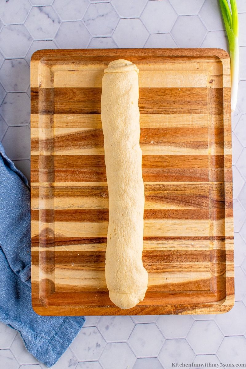 The dough tightly wrapped into a log.