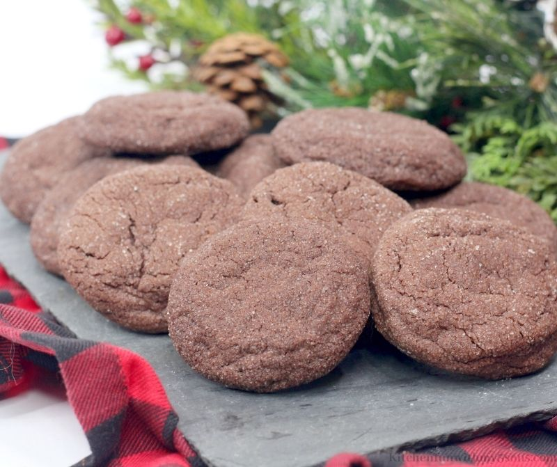 Chocolate Snickerdoodles on a gray slate on top of a flannel cloth.