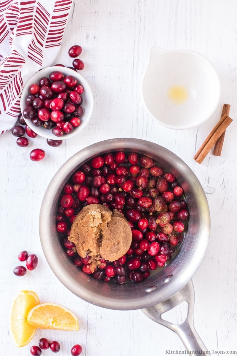 Mixing the spices into the cranberries.