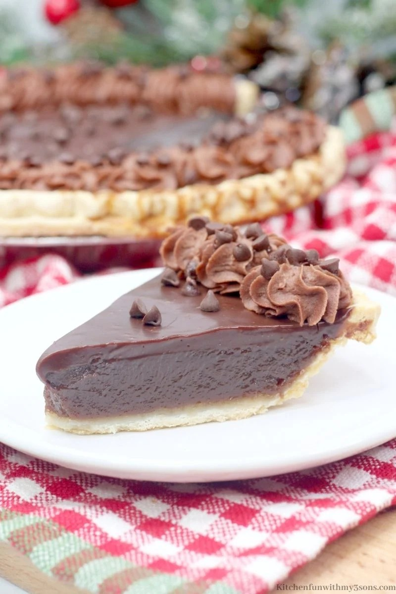 Decadent Chocolate Buttermilk Pie on a white and red checkered cloth.