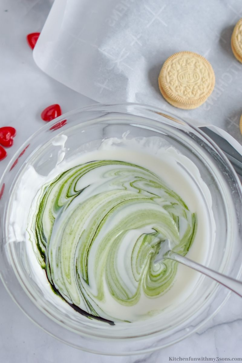Adding the green food coloring into the batter.