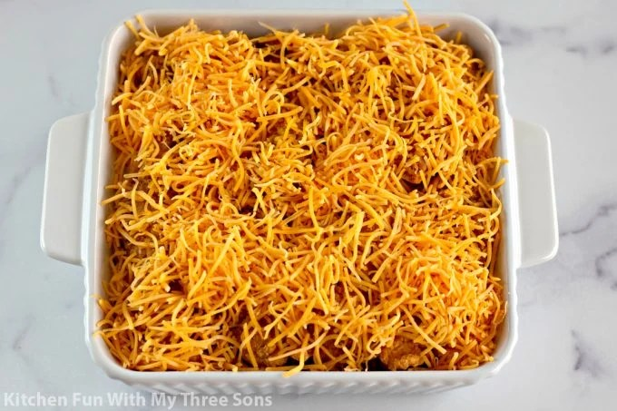 shredded cheese over top of the casserole