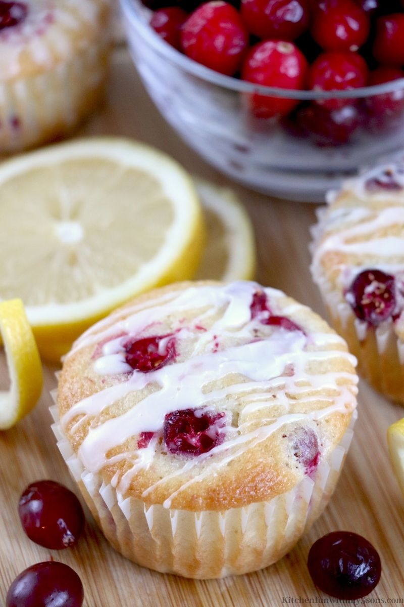 Lemon Cranberry Muffins Recipes on a wooden cutting board.