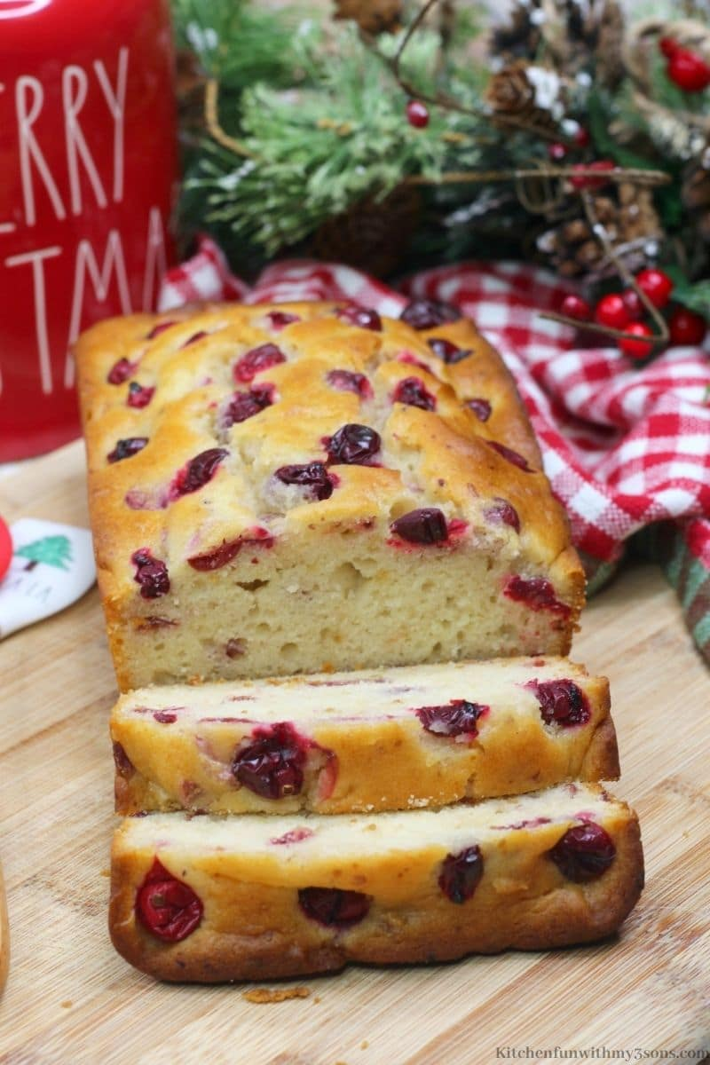 Orange Cranberry Bread with a Christmas jar behind it.