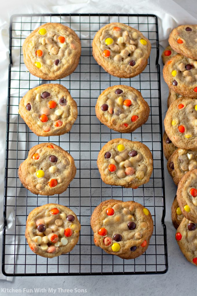 Reese's Pieces Cookies on a wire cooking rack