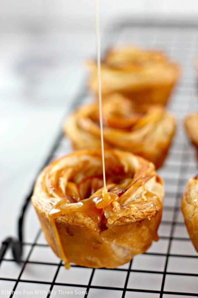 drizzling caramel over the Caramel Apple Rose Tarts